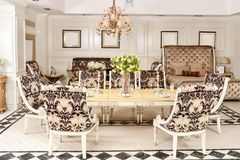 Furniture in luxury dining room royalty free stock image