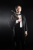 Classical man studio portrait with french horn Royalty Free Stock Images