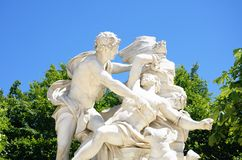 Classical marble statue with figures Stock Images