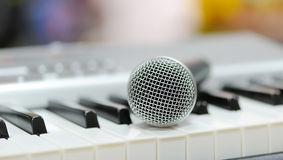 Classical microphone on keyboard Stock Image