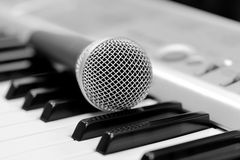 Classical microphone on keyboard Stock Photography