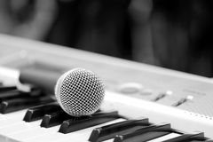 Classical microphone on keyboard Stock Photo