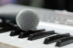 Classical microphone on keyboard Royalty Free Stock Photos
