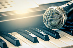 Classical microphone on keyboard Stock Photos