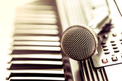 Classical microphone on keyboard Royalty Free Stock Images