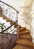 Classical mosaic stairs with ornamental handrail in hallway with Royalty Free Stock Images