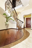 Classical mosaic stairs with ornamental handrail in hallway Stock Photo