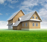 Classical mountain cottage with green grass and blue sky Royalty Free Stock Photos