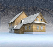 Classical mountain cottage at night snowfall Royalty Free Stock Photo