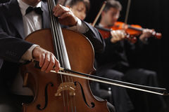 Classical music, cellist and violinists Royalty Free Stock Photos
