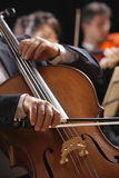 Classical music, cellist and violinists Royalty Free Stock Photography