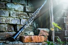 Classical Music Concept. Old Clarinet In Sunlight Against Background Of Ancient Brick Wall Royalty Free Stock Image