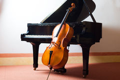Classical music. Concept: violin leaning on a piano Royalty Free Stock Photos