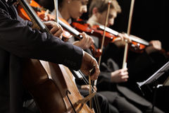 Classical music concert. Symphony concert, a men playing the cello, hand close up Stock Photos