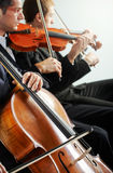 Classical music: concert. Cellist and violinist playing at the concert stock photos