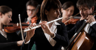 Classical music concert: flutist close-up stock images