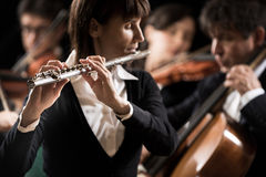 Classical music concert: flutist close-up Stock Photos