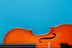 Classical music concert poster with orange color violin on blue background with copy space stock photography