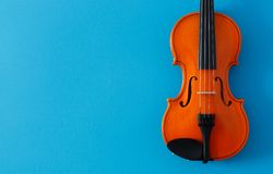 Classical music concert poster with orange color violin on blue background with copy space royalty free stock image