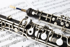 Classical music instruments oboe. Playing. Musical instrument with music sheet notes Stock Images