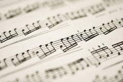 Classical music - notes on vintage sheet. (shallow DOF stock images