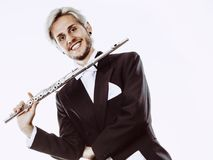 Male flutist wearing tailcoat holds flute Stock Photography