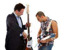 Classical music versus rock music. White background Royalty Free Stock Image