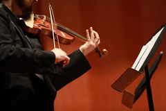 Classical music. Violinists in concert. Stringed, violinist.Closeup of musician playing the violin during a symphony. Classical music. Violinists in concert Royalty Free Stock Images