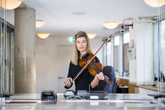Classical Musician behind ticket counter stock photography