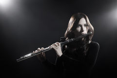 Classical musician with flute instrument Royalty Free Stock Image