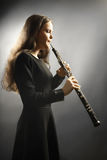 Classical musician oboe musical instrument playing. Classical musician oboe playing. Oboist with orchestra musical instrument Royalty Free Stock Photography