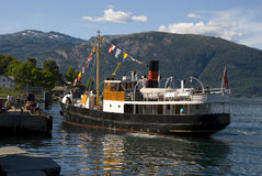 Classical old steam boat on hardangerfjord, norway Stock Photos