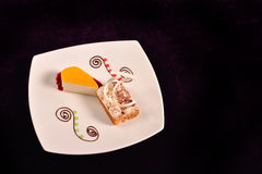 Classical orange cheese cake with cherry sauce and dessert with Royalty Free Stock Image