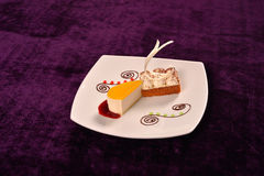 Classical orange cheese cake with cherry sauce and dessert with Stock Photo