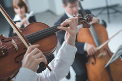 Classical orchestra string section performing Stock Image