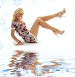 Classical pin-up blonde on white sand Royalty Free Stock Photo