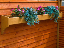 Classical planter flowerpot on a garden fence Stock Photos