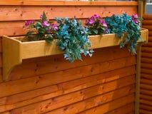 Classical planter flowerpot on a garden fence stock photos