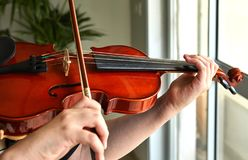 Classical player hands. Details of violin playing stock images
