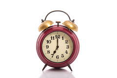 Classical red alarm clock on white background Royalty Free Stock Images