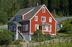 Classical red norwegian wooden house, scandinavia. Classical red norwegian wooden house in scandinavia stock photography