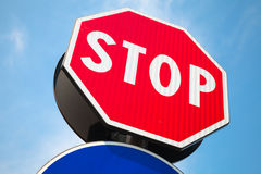 Classical red Stop road sign over blue sky Royalty Free Stock Photo