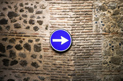 Classical road sign on ancient wall Stock Photos