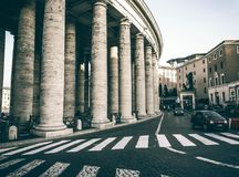 Classical Roma double collonade. The double colonnade corridor of St.Peter Church and the Vatican town, Italy Royalty Free Stock Photo