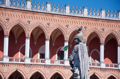 Classical sculpture. One of the sculptures of famous Padova people standing round Pratto della Valle, Padova, Veneto, Italy, with a pgeon on its helmet against Stock Photo