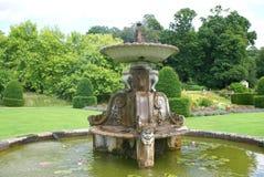Classical sculptured fountain in a garden Stock Photos