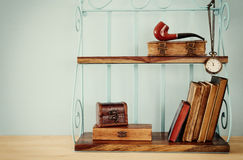 Classical shelf with vintage male objects Royalty Free Stock Photos