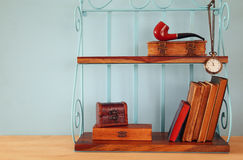 Classical shelf with vintage male objects Royalty Free Stock Photography