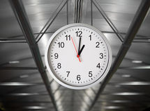 Classical simple clock hanging in interior Royalty Free Stock Photo