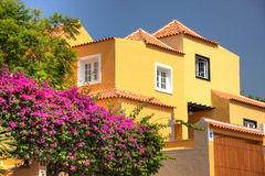 Spanish villa property house vacation home exterior for sale Spain tropical flowers apartment building village real estate greek. Classical spanish architecture Royalty Free Stock Images